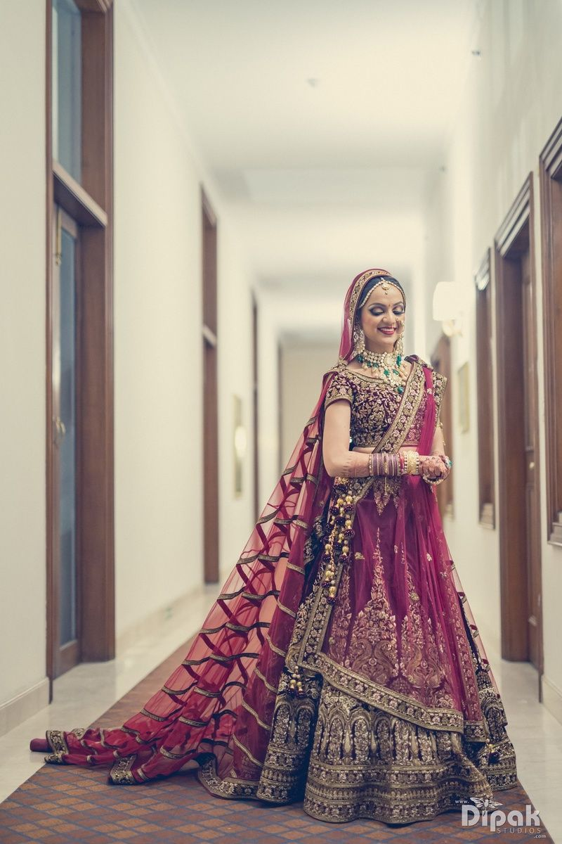 f83d752f58 Bride in a Beautiful Wine Colored Lehenga with Matching Long Dupatta