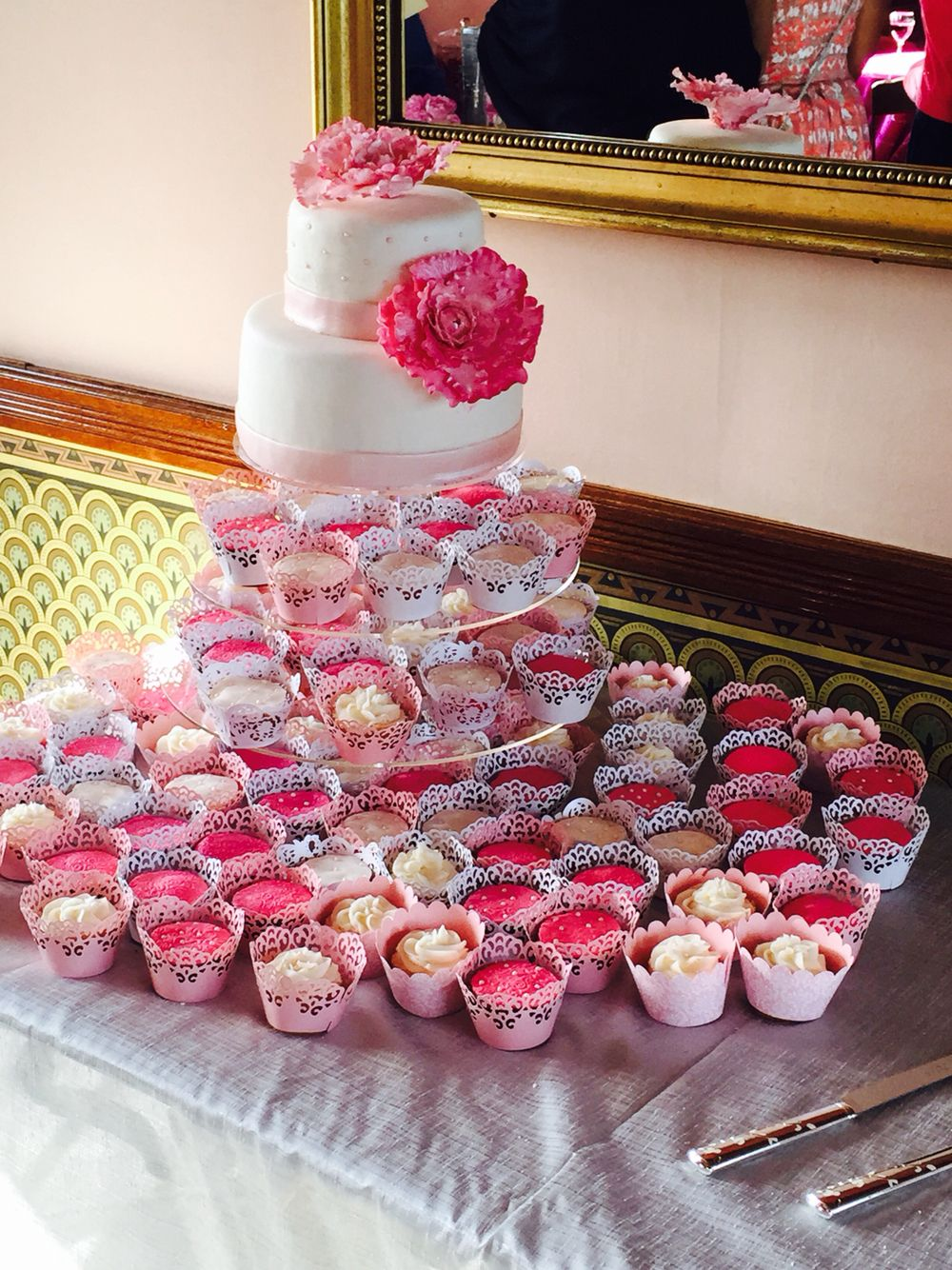 Pink peonies on wedding cake with cupcakes | cousin stacy cakes ...