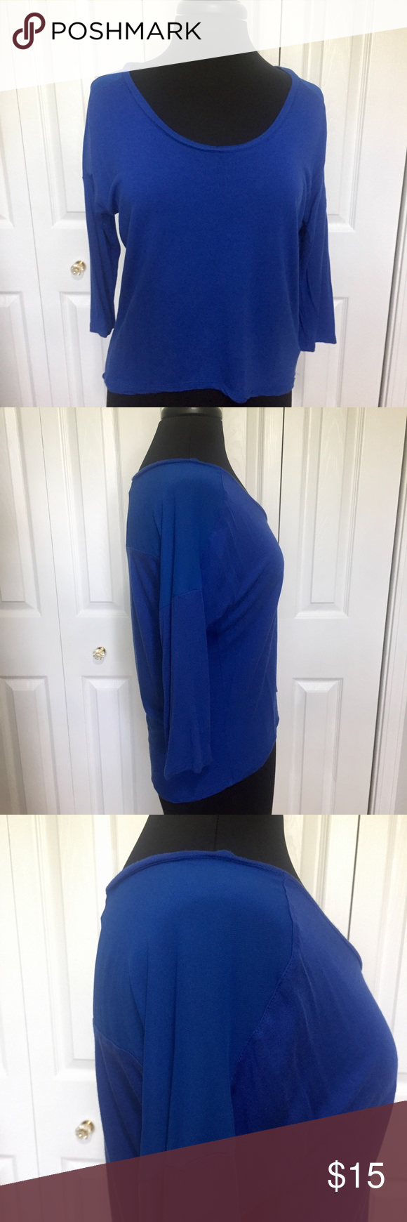 Marcelle blue 3/4 sleeve top with sheer inserts This top is in good condition without any rips or stains. Hi-lo, 3/4 sleeve, with sheer insert in back and top of sleeve area. Unable to get accurate sleeve length measurement due to make of sleeve. Measurements taken flat and in inches. Armpit to armpit 23. Center front to hem 14. Center back to hem 221/2. Marcelle Tops Blouses