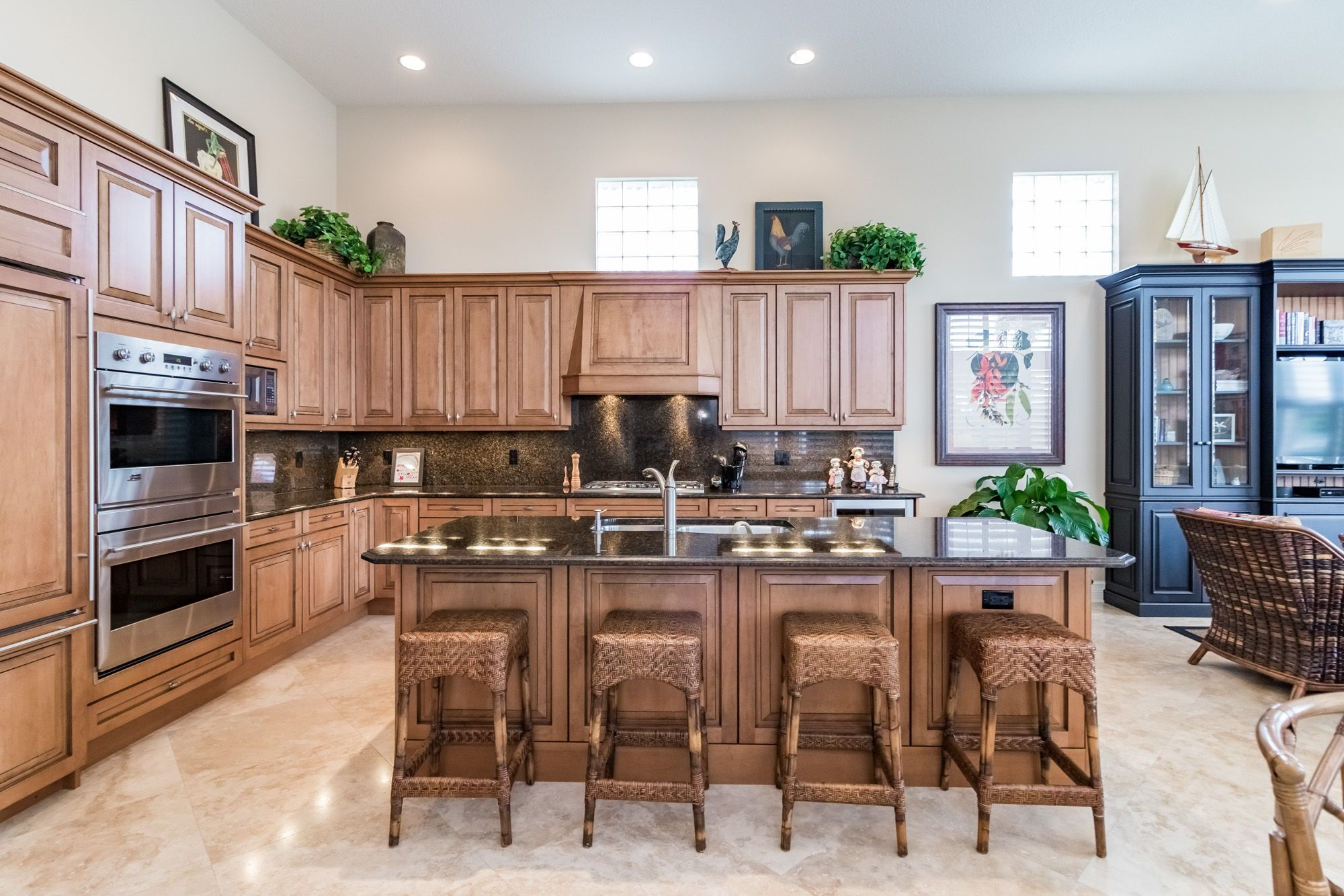 The Kitchen Has Custom Irpinia Caramel Colored Maple Wood Cabinets