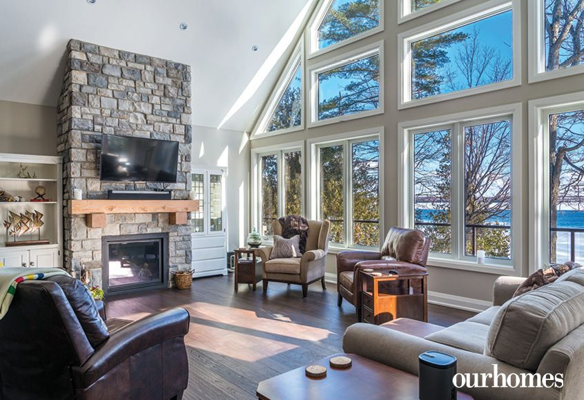 In The Great Room Stone Veneer Encases The Gas Fireplace