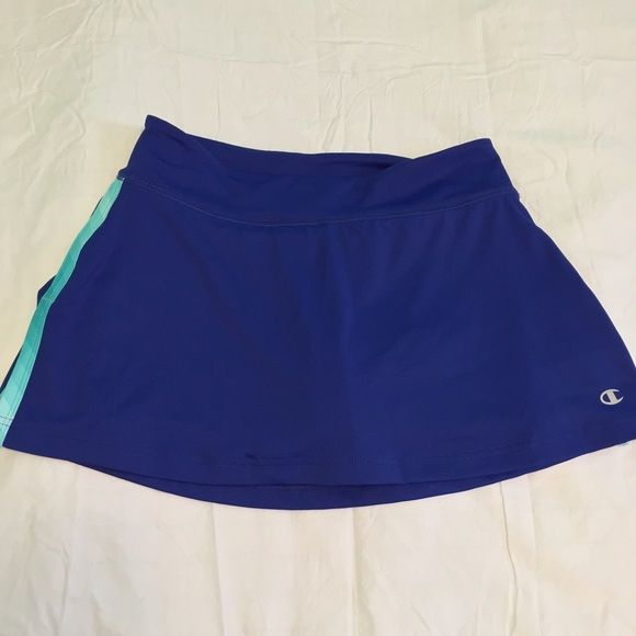 NWOT Champion Workout Skirt Blue workout skirt with turquoise green shorts underneath. Very cute and stylish for working out and in perfect condition! Not Nike. Nike Skirts