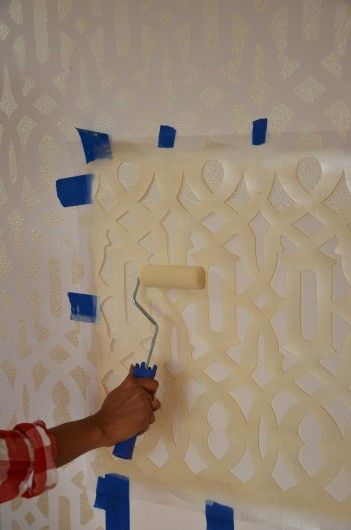 A Glamorous Trellis Stenciled Accent Wall Metallic gold paint