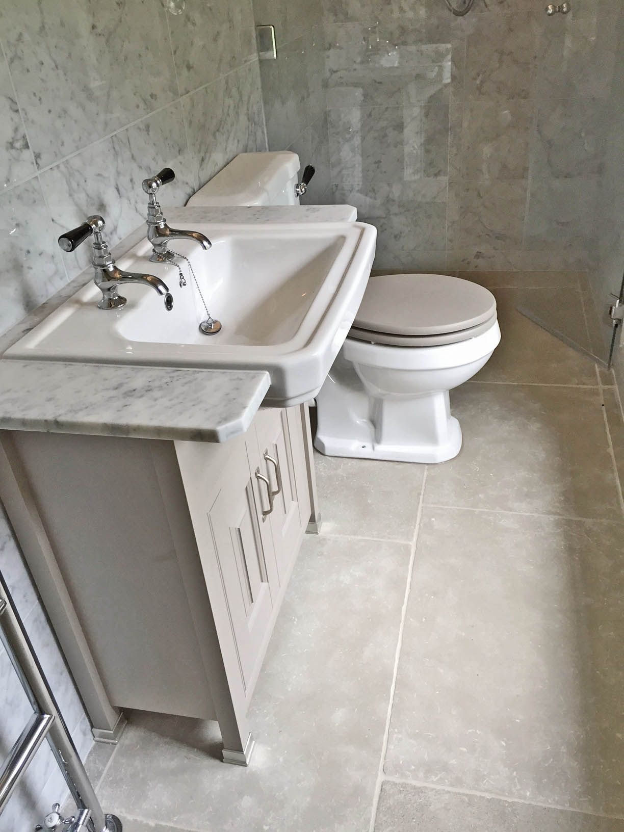 Paris grey limestone and carrara marble tiles were used on the stone flooring flagstones and tiles natural stone consulting dailygadgetfo Image collections