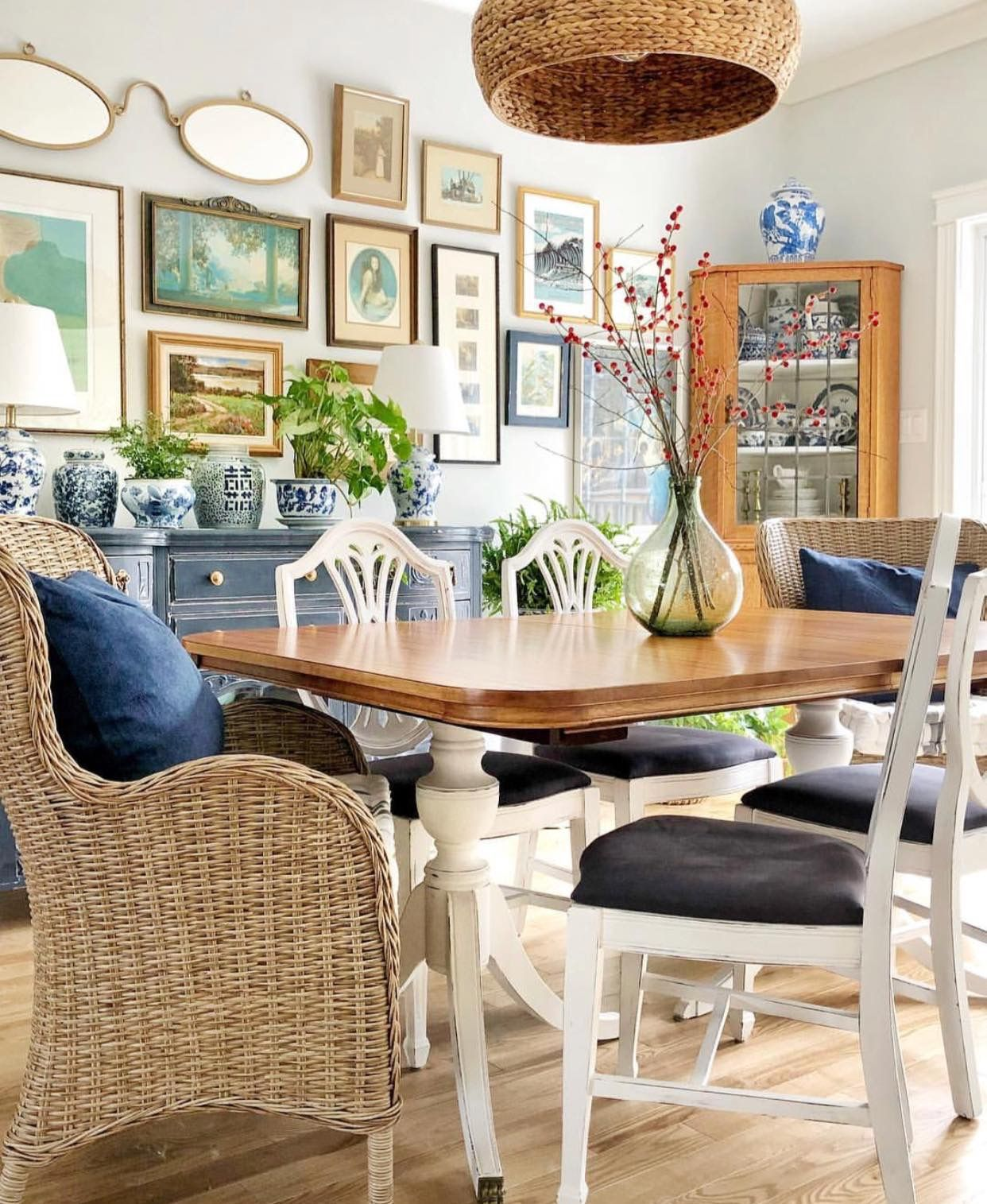 Like the wallscape, wicker chairs, color of the chest. Via ...