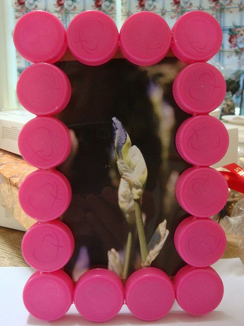 Plastic Bottle Cap Photo Frame except instead of plastic, use those Smirnoff caps! ;)