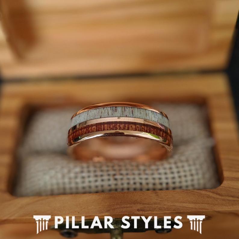 This stunning 18K rose gold ring features exotic Hawaiian koa wood and bold deer antler inlaid within the band. The striking color play between natural earth elements and the shiny rose gold finish really gives you the