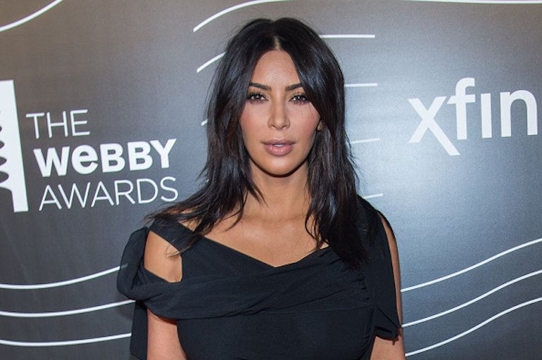 Kim Kardashian Proudly Flaunts Curves in Bathing Suit - See the pic!