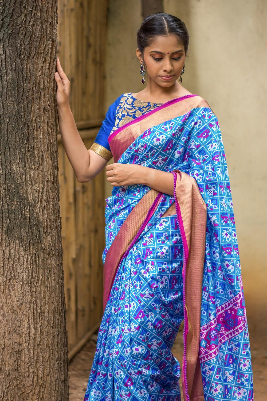 Tissue silk saree blue and purple patola inspired semi silk saree with a rich tissue