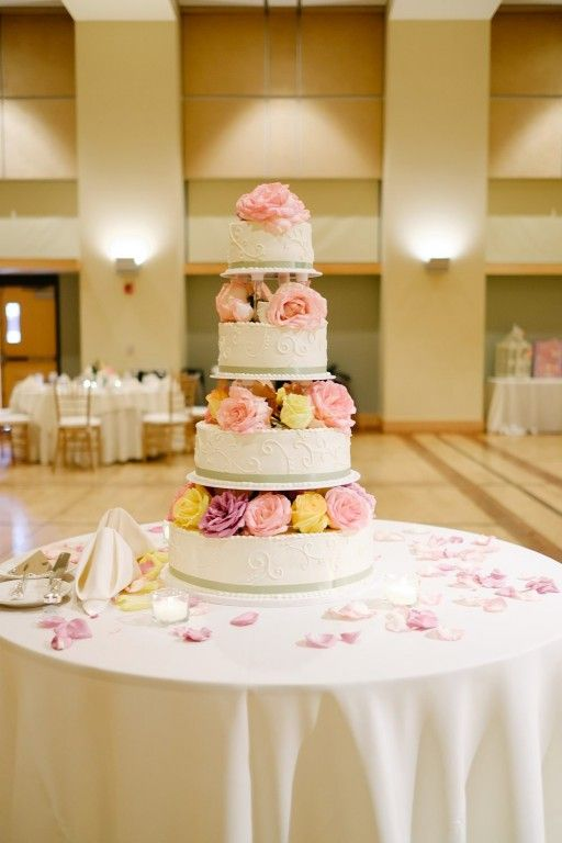 4-Tier White Wedding Cake on Table Covered in Tea Light Candles ...