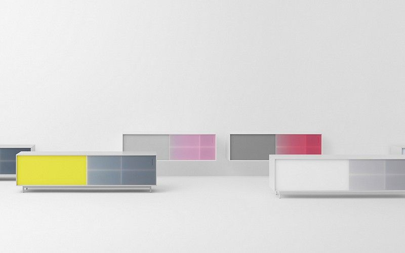 SHIFT   Shift combines a minimalist shape with an expressive use of colors. Thanks to its colored, translucent sliding doors, an intriguing play of colors occurs when the cabinet is opened and closed.