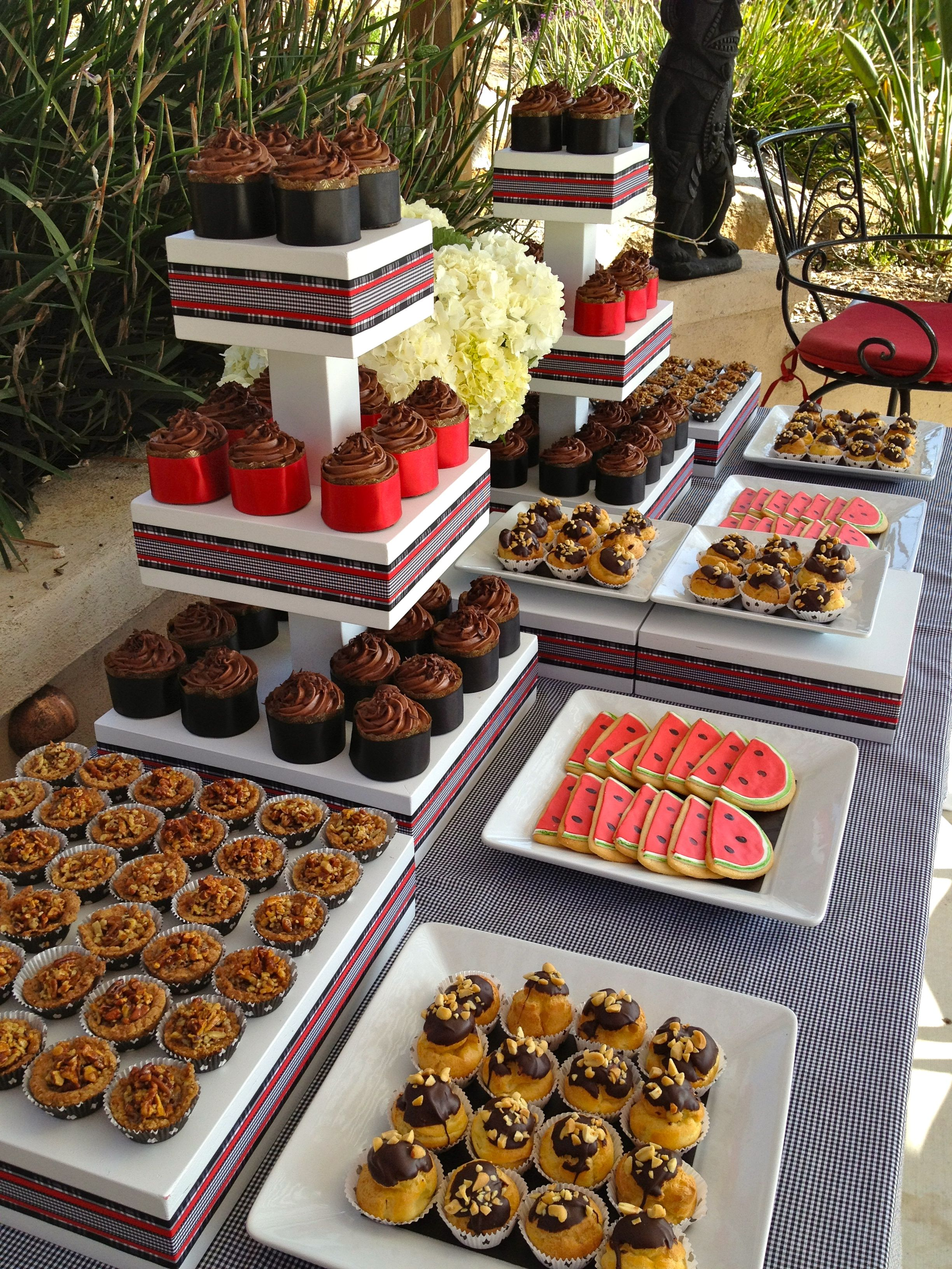 dessert table at backyard wedding reception sweets