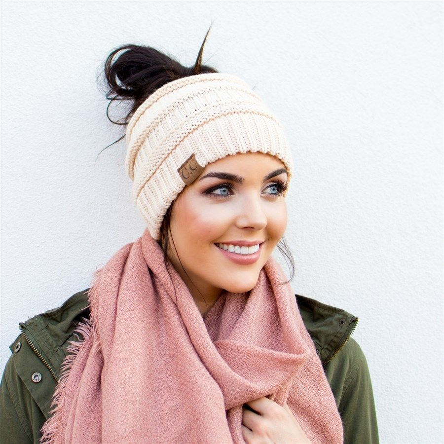 e4e57438bea Our C.C brand top knot beanies are the solution to wearing your hair up  while keeping you warm and in style. Perfect for those messy buns