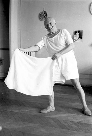"11 Pablo Picasso holding out a towel the way a bullfighter holds out his cape. ""The morning after bullfights in Arles, Picasso spun around with his bath towel, baiting Jacqueline across the room. [Villa La Californie, 1957.]"" Viva Picasso, p. 139 HRC"