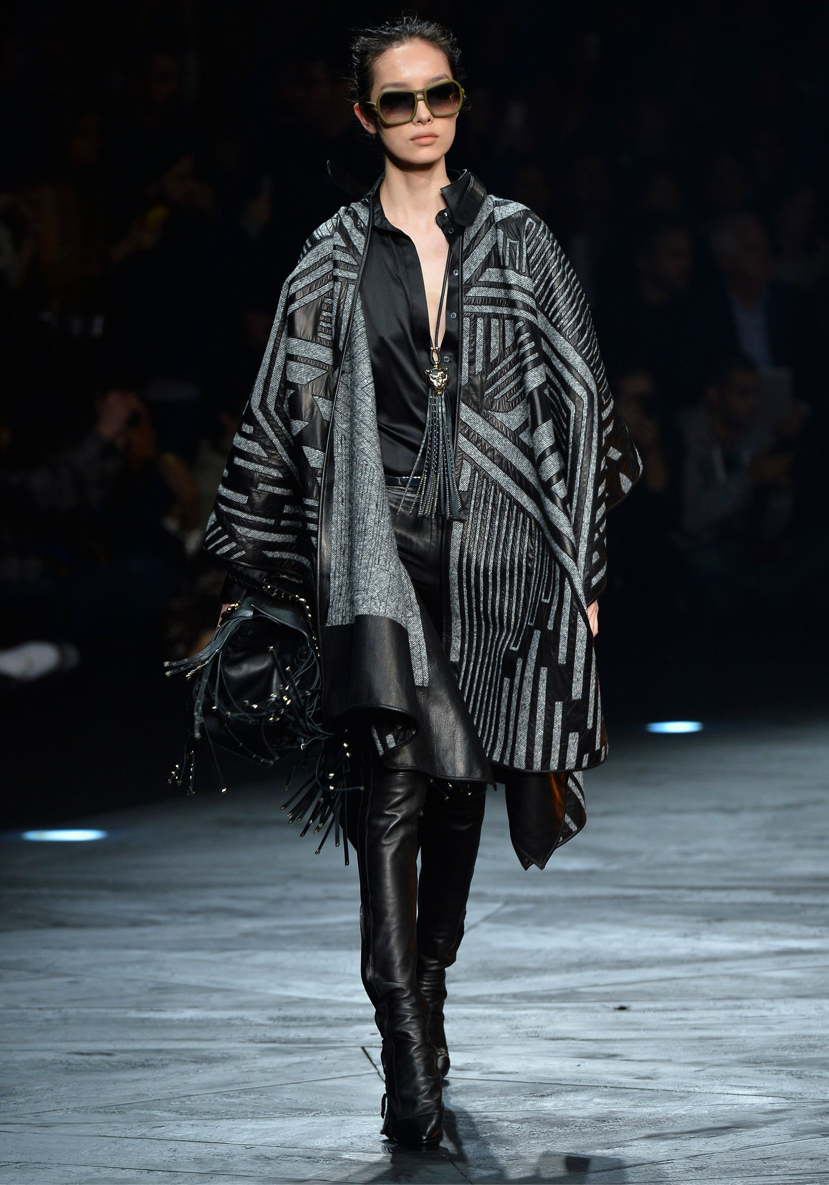 #RobertoCavalli FW14 runway show - The equestrian-chic atmosphere is highlighted by leather pants, military shapes and enveloping blanket coats.