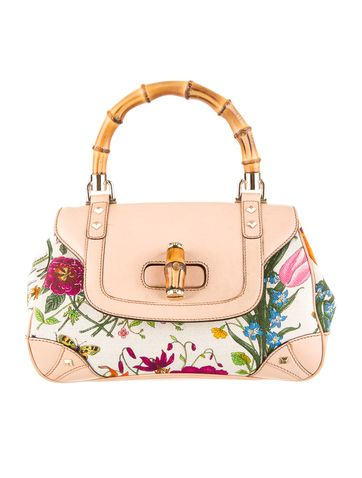 52bb1571b2f Must Have  Gucci Flora Bag.