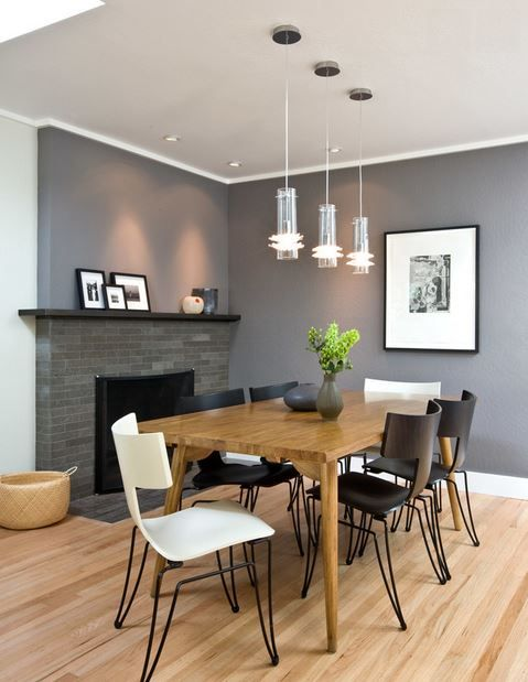 Limestone Fireplace Facade With Custom Metal Mantle For Eclectic Dining Room Designs