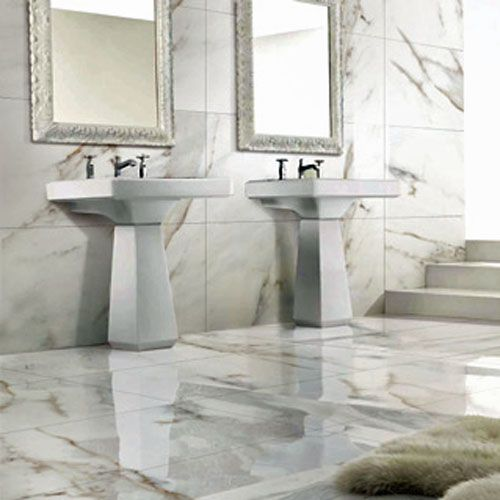 A traditional luxury bathroom featuring white and grey CARRARA