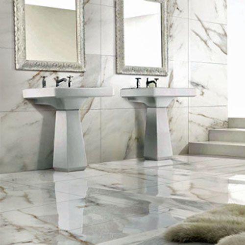 A Traditional Luxury Bathroom Featuring White And Grey Carrara Polished Marble Effect P Porcelain Tile Bathroom Bathroom Wall Tile Design Trendy Bathroom Tiles