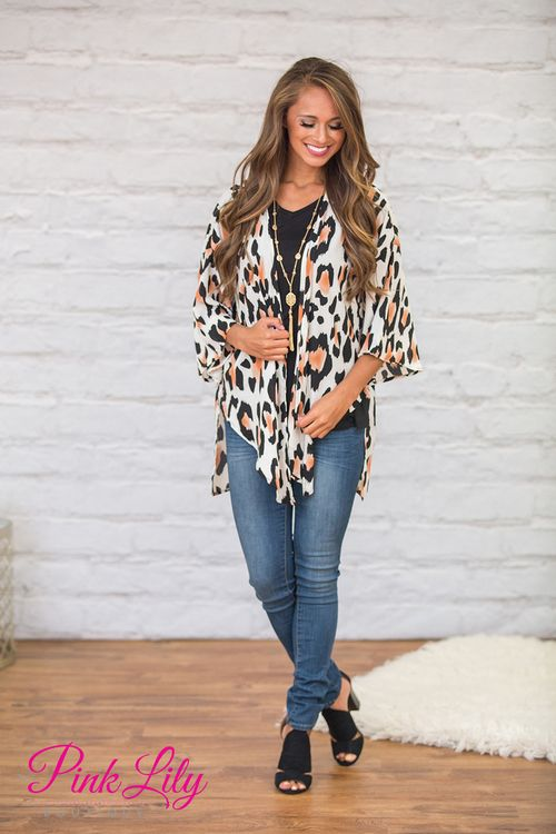 This beautiful printed kimono will have you feeling fabulous and confident all day long! Featuring a bold animal print in sepia, black, and cream, this print is simply stunning!