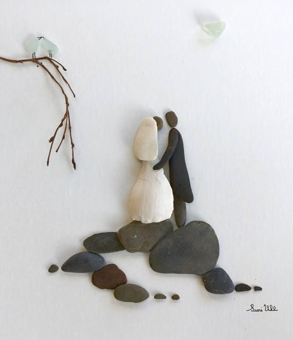 Pebble Art Wedding Couple Bride and Groom Art Modern Wall Art Abstract Contemporary Signed. This signed original pebble art is made by me, Susi Uhl. The pebble art is a unique style made of pebbles collected by me. The birds and the heart are genuine Sea Glass. This art would be a perfect wedding gift for couple, romantic pebble art, engagement, anniversary, bride and groom gift, Wedding fine art, bridal shower gift idea. Customizable. The art comes in a 10 x 13 grey silver shadow box made…