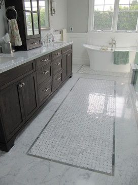 tile floor: large tile around perimeter and a decorative