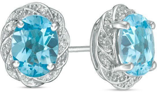 Zales Oval Onyx and 1/20 CT. T.w. Diamond Pinwheel Frame Stud Earrings in Sterling Silver zl1P8r