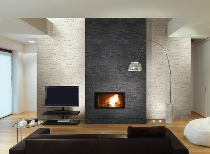 grey stone tile pattern . A massive fireplace made out of metal is ...