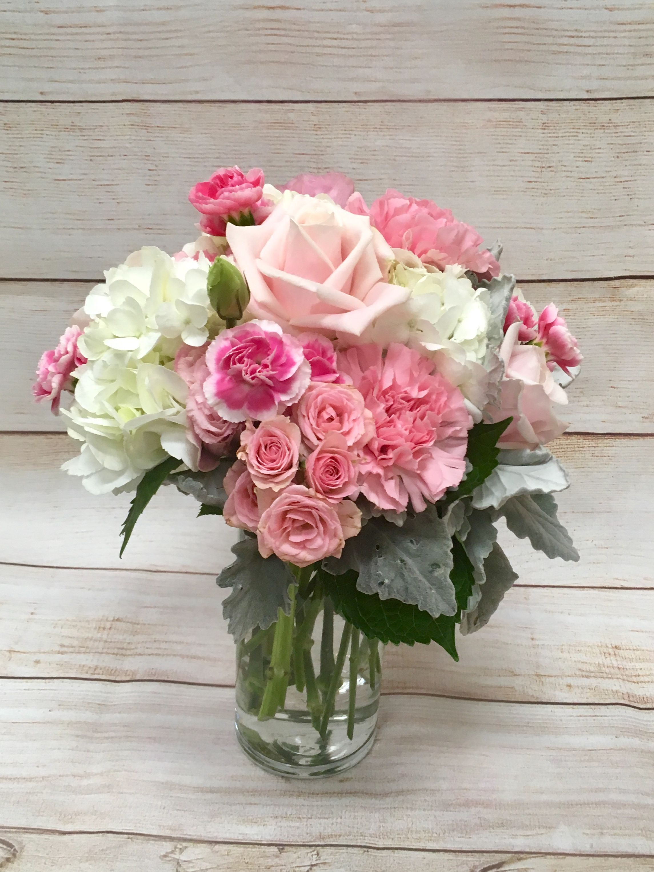 Pretty N Pink Centerpiece Made Of Hydrangea Roses And Mini Carnations Pink Flower Arrangements Flower Arranging Class Mini Carnations