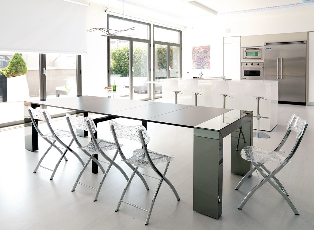 Goliath Glass telescoping table extends enough to seat 10 Looks
