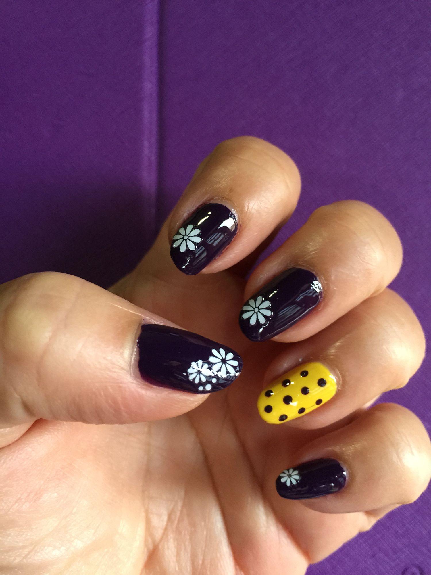 Royal purple with white daisy n yellow polka dots nailart