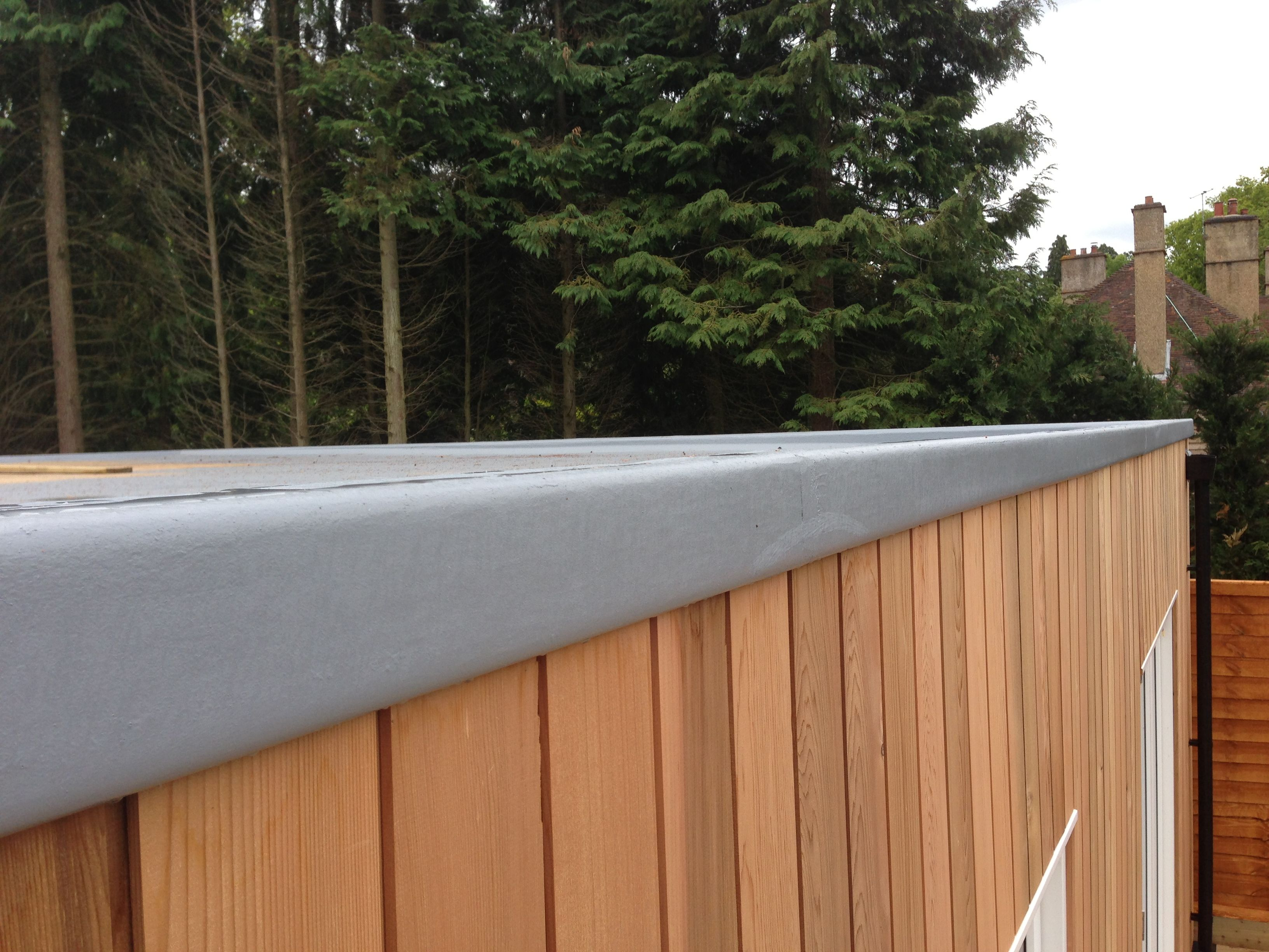 GRP Roof Against Cedar Cladding