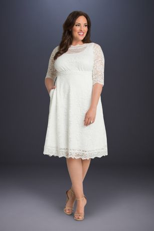 592e15276b5 This short lace plus-size wedding dress features an illusion boatneck  neckline, 3/4-sleeves, and, best of all, pockets! The A-line silhouette  flatters ...