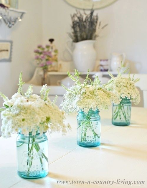 Wildflowers In Blue Mason Jars For Summer Decorating Via Town And Country Living Summer Decor Summer Flower Arrangements Cottage Style Decor