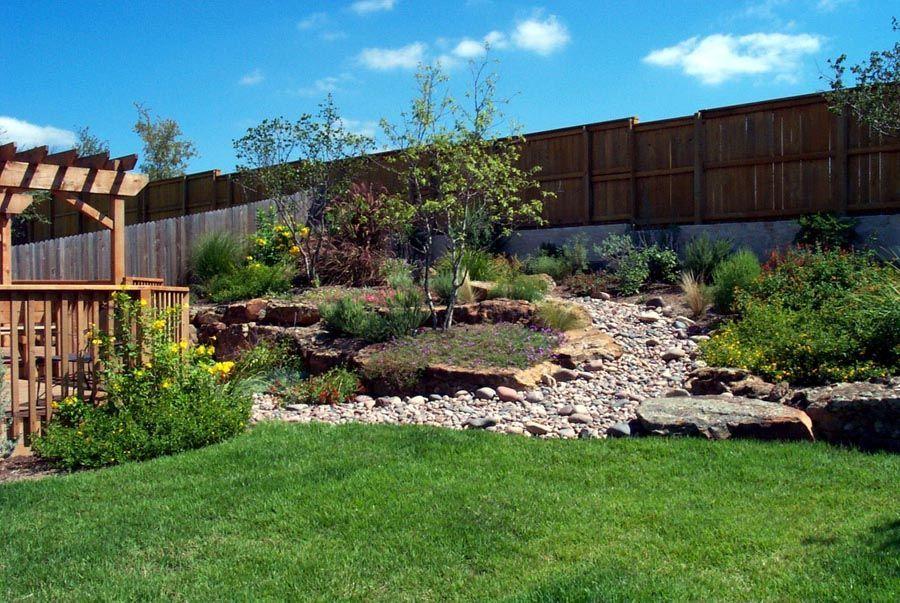 Chic Landscape Ideas For Hillside Backyard Sloped Backyard ...