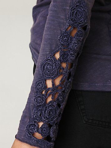 Just a touch of lace in the sleeve. Could fix a hole or stain this way.