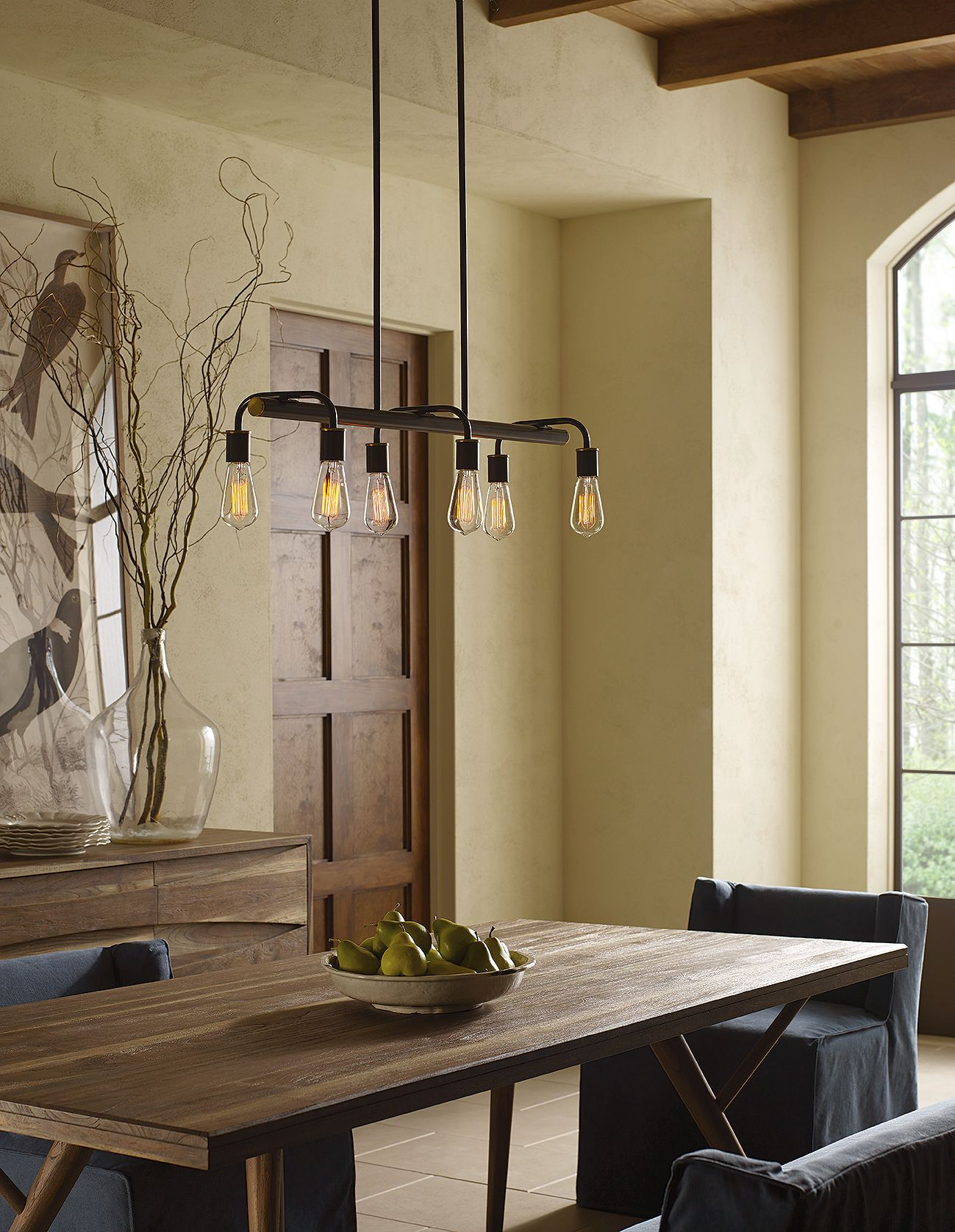 A vintage chandelier with exposed lamps pairs well with a rustic