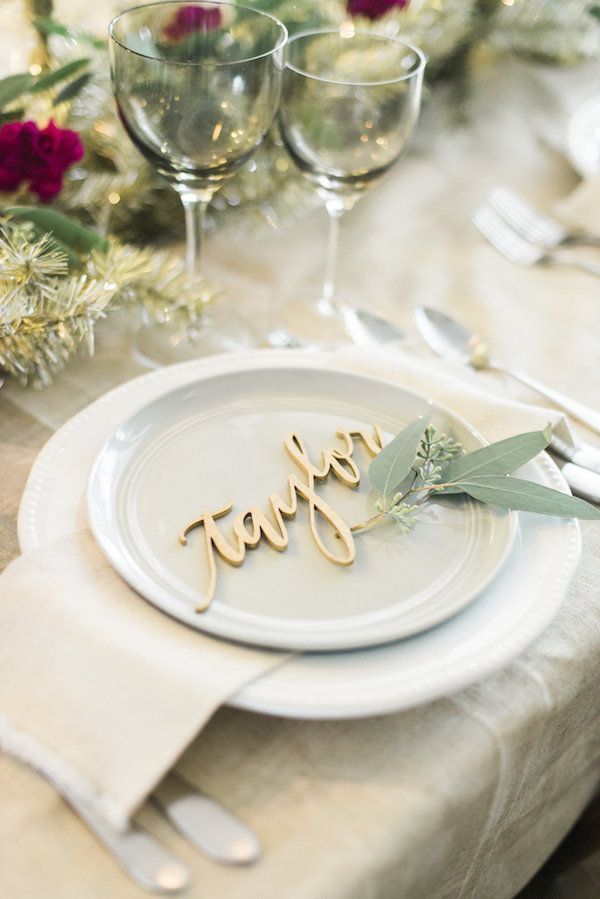 A Metallic Holiday Table Laser Cutting Cards And Place