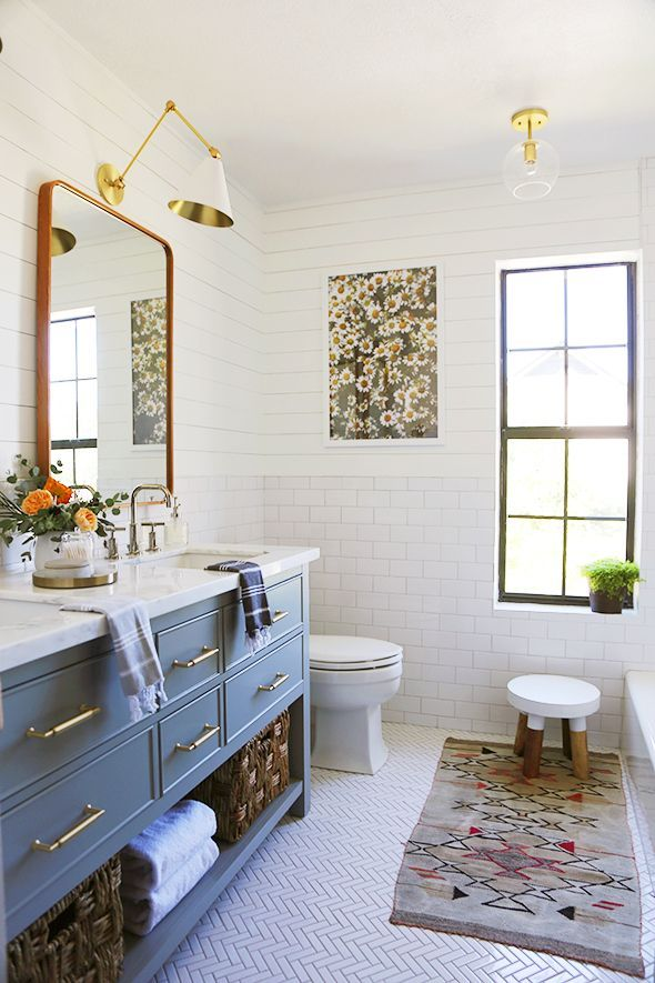A small stylish bathroom with plenty of built in storage under the