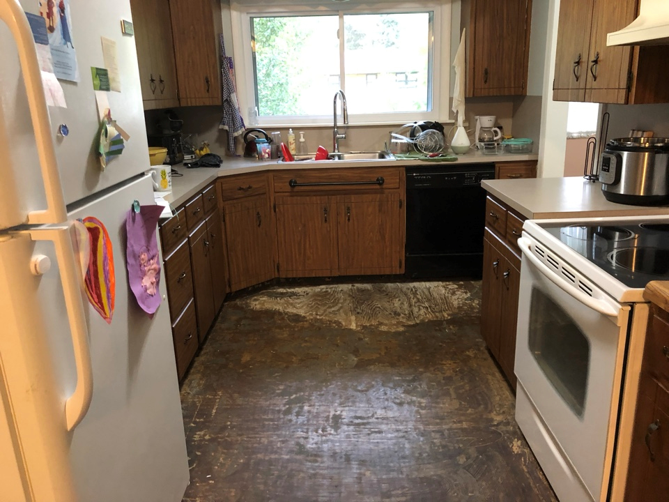 Water Line Broke On The Refrigerator Water Damage To The Kitchen Floor And Cabinets Kitchen Flooring Kitchen Kitchen Cabinets