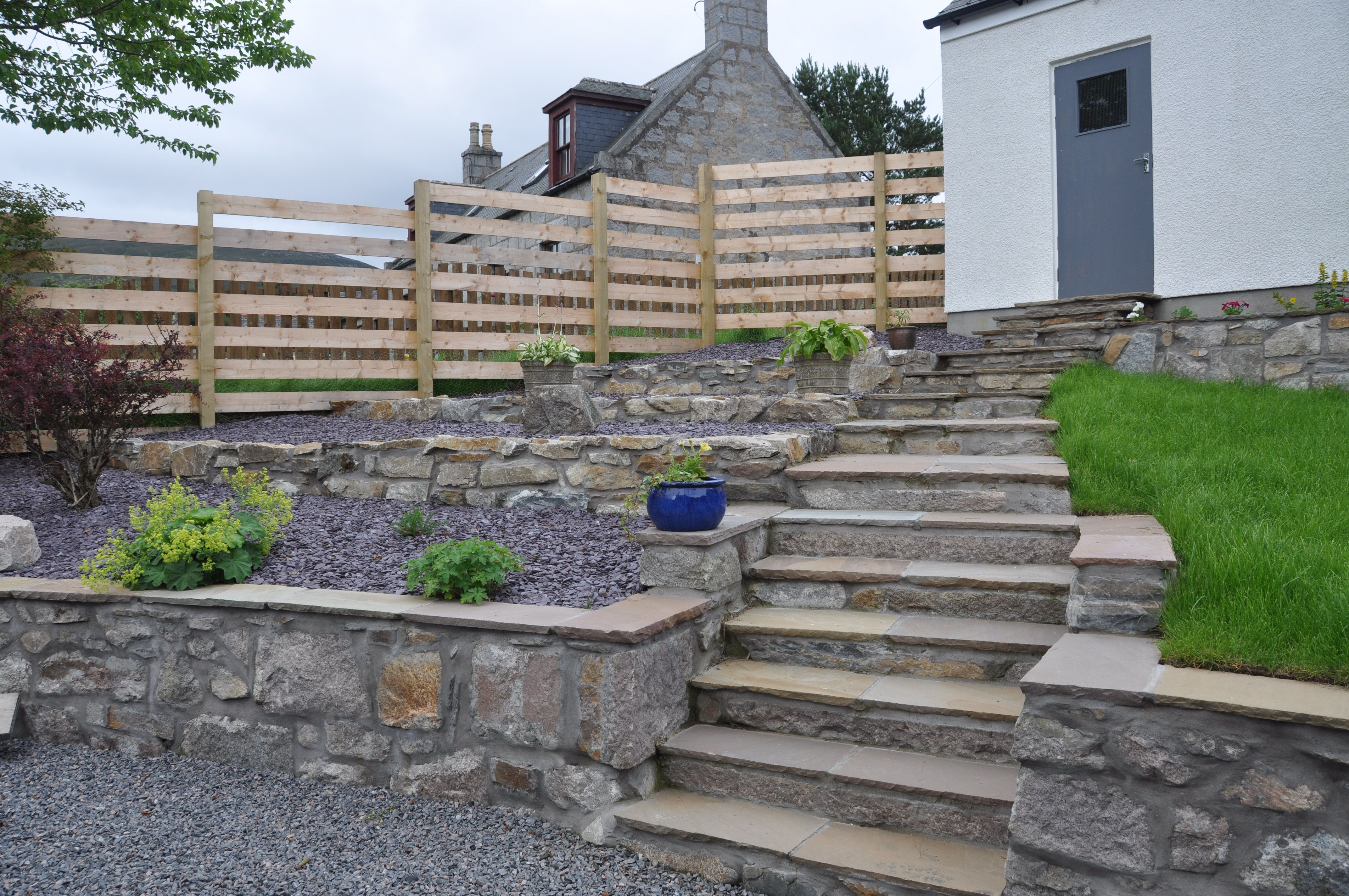 natural stone walls and step risers with sandstone step treads