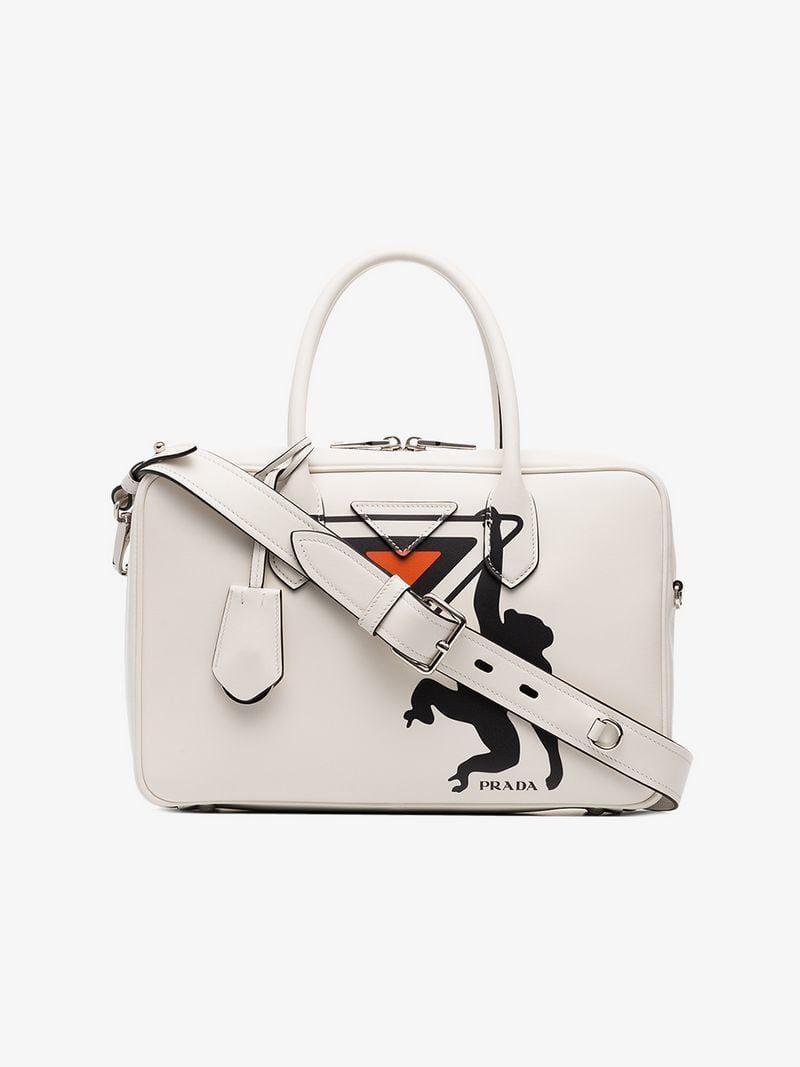 60411a90f9d4 PRADA | White Monkey Print Leather Bowling Bag | $2,950 | This white Prada  monkey print