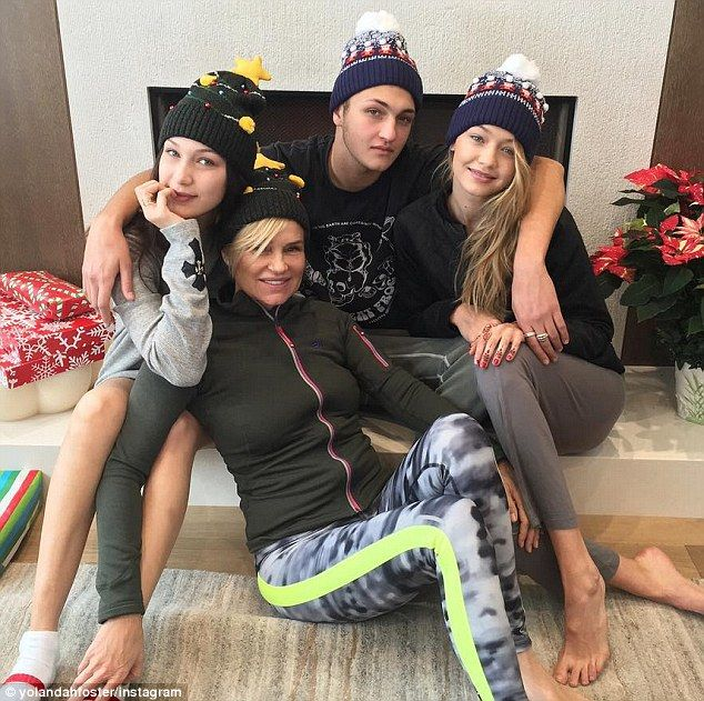 Yolanda Foster cuddles with Gigi, Bella and Anwar on Christmas