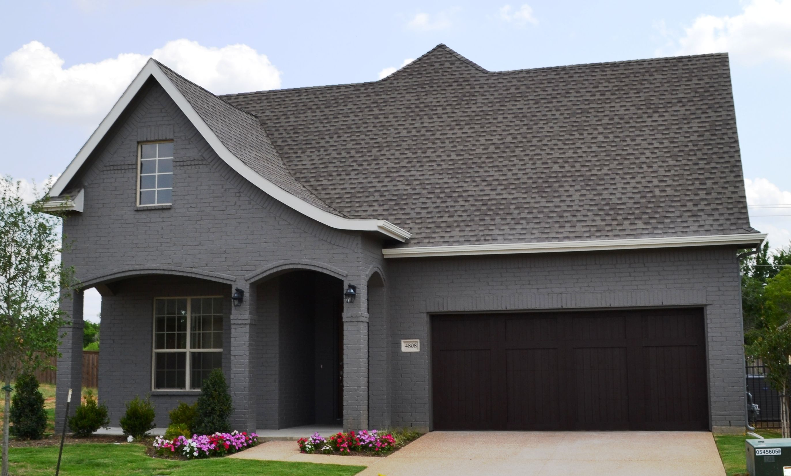 Village homes dark grey painted brick with light grey for Light gray exterior paint