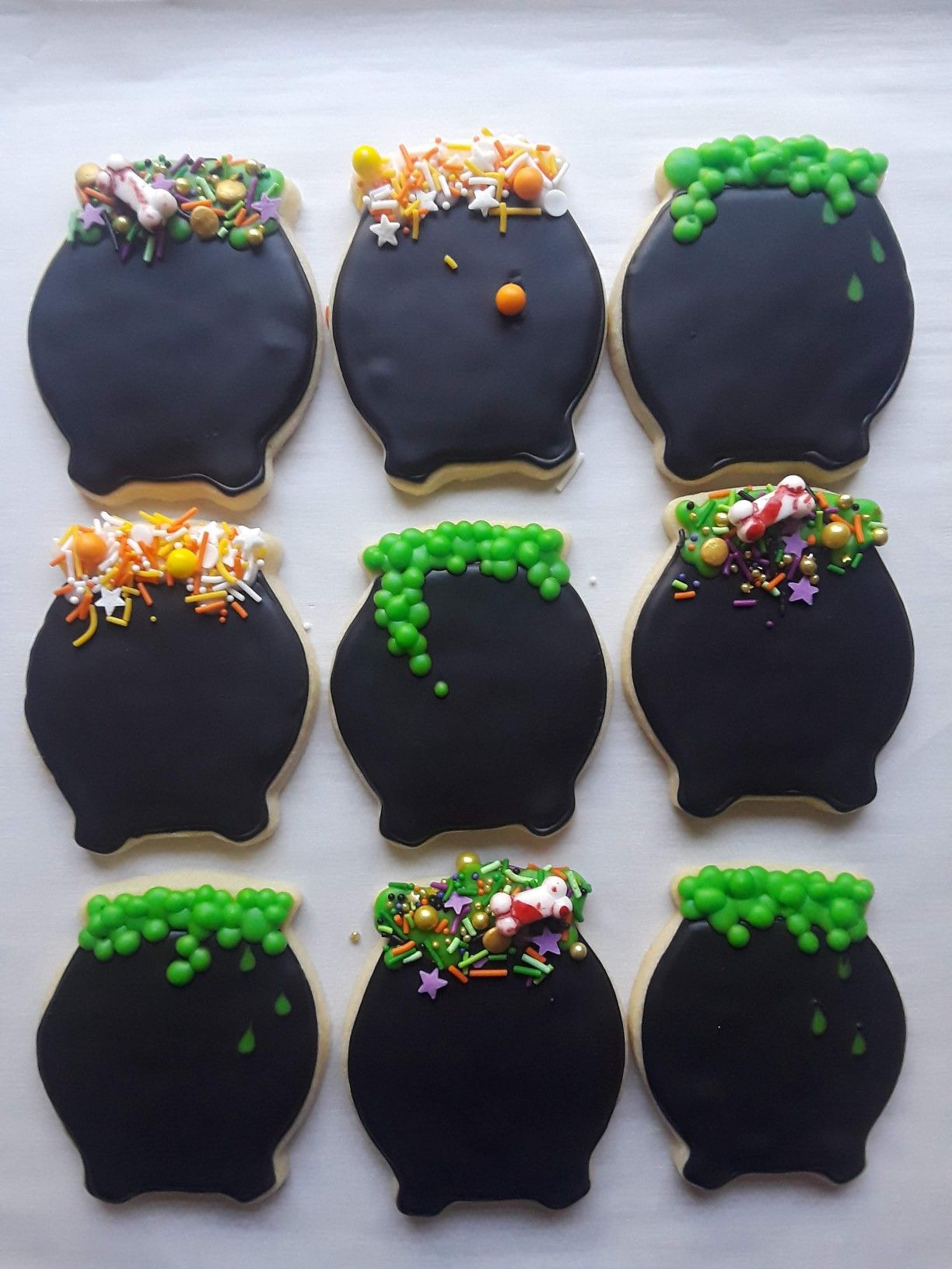 Cauldron decorated sugar cookies with witch's brew sprinkles  #halloween #fancysprinkles #cauldron #cauldroncookies #sugarcookies #decoratedcookies #cookiedecorating #sprinkles #customcookies #halloweencookies