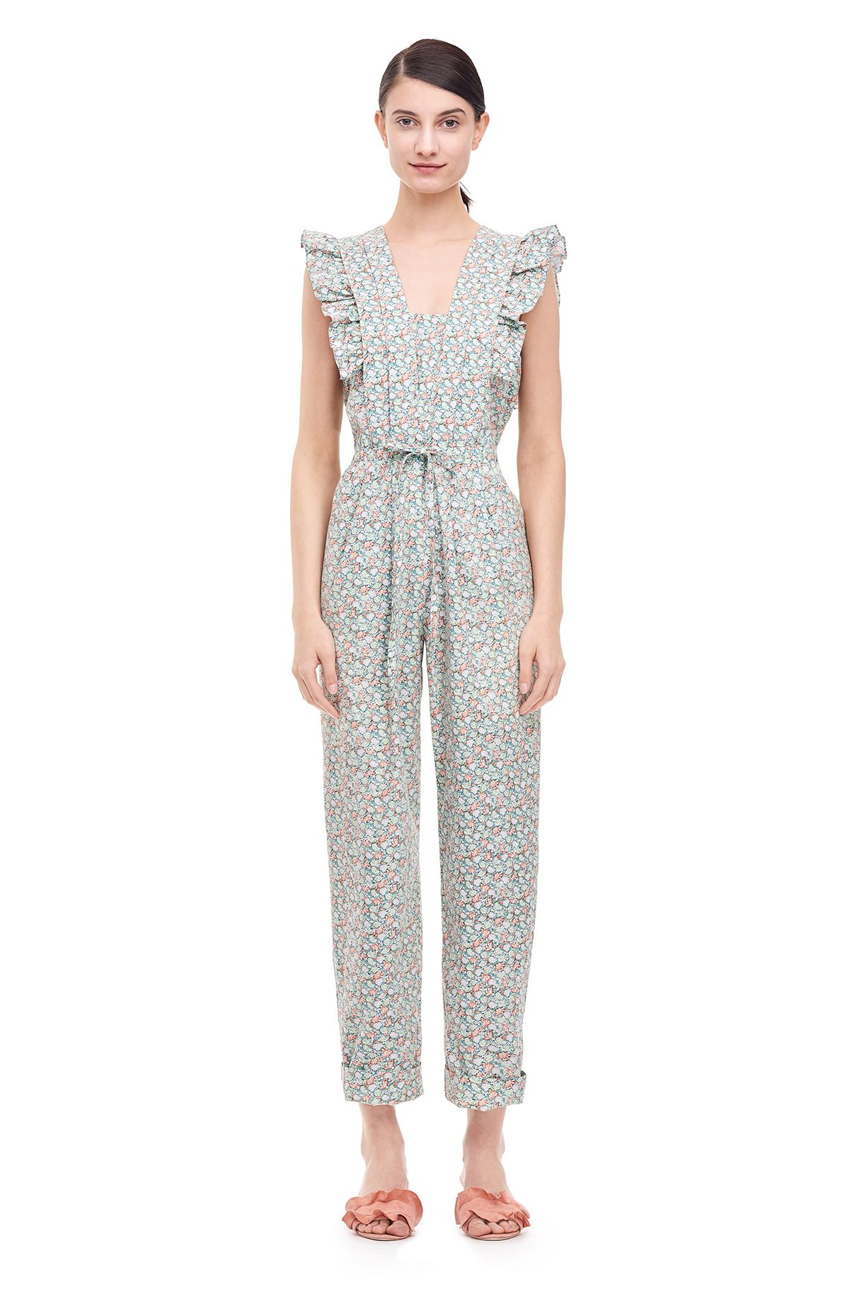 A floral-print jumpsuit with ruffles and pintucks.