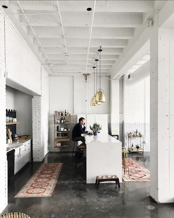 Loft kitchen with vintage rugs