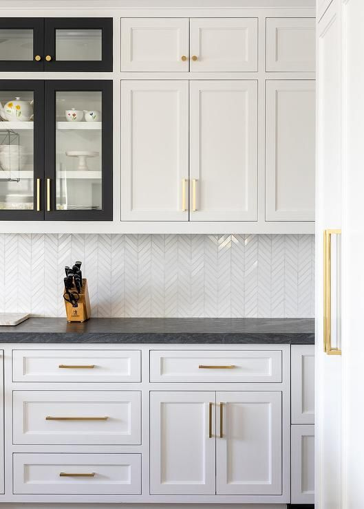 White shaker kitchen cabinets with various black frame ...
