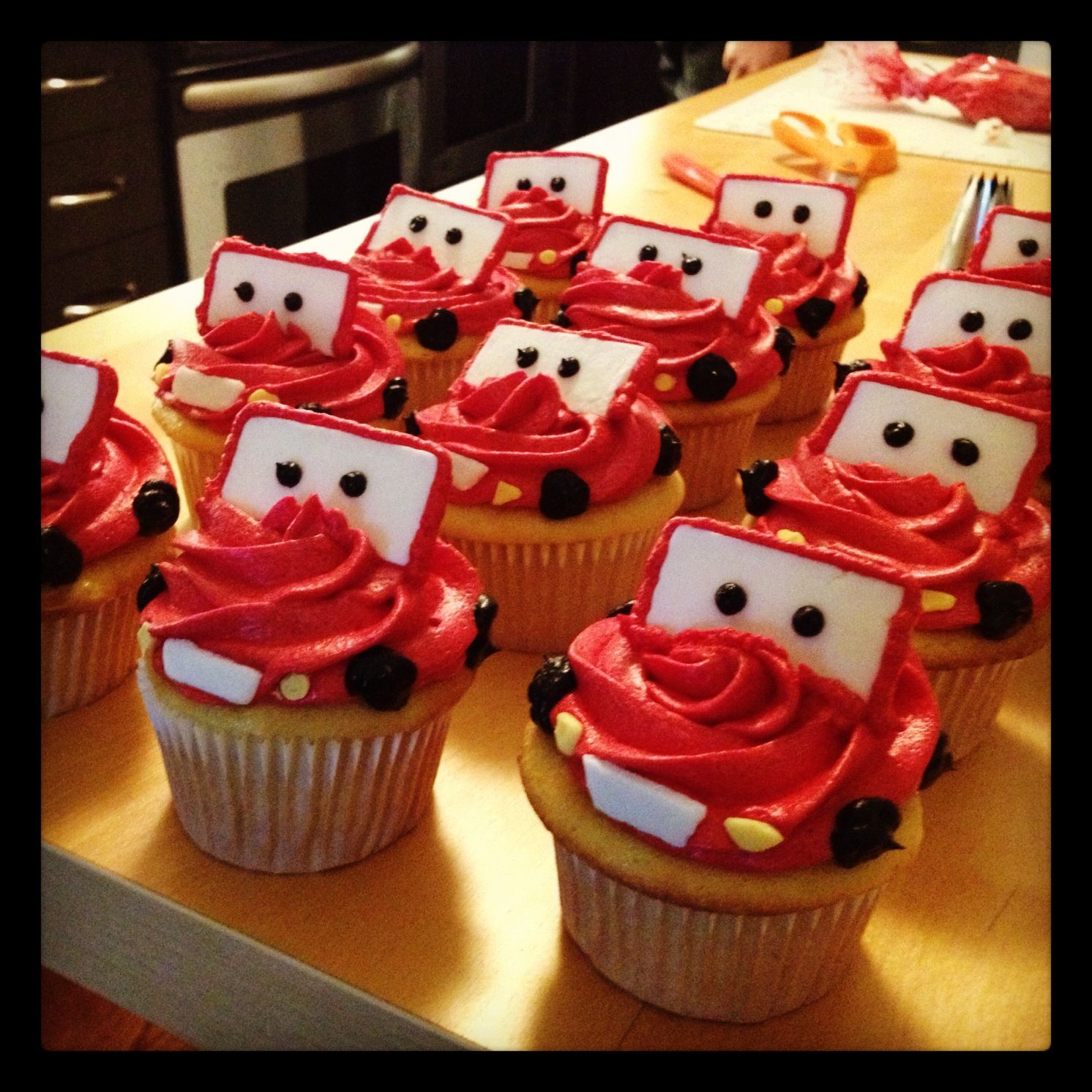 Cars Lightning McQueen Cupcakes in chocolate frosting these