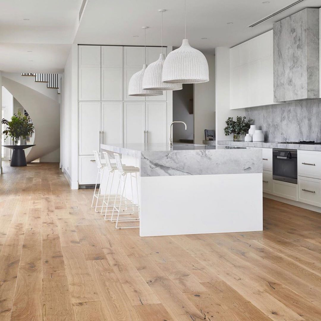 Light and airy white modern kitchen with white oak